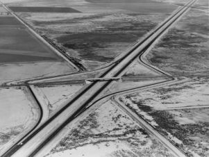 Interstate 10 southeast of Casa Grande, Arizona, 1967 Federal Highway Administration The new interstates that were built to connect the larger economic and populations centers by-passed the small towns business centers. Hotels, gas stations and restaurants relocated to the large interchanges.
