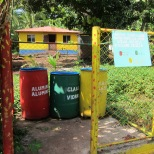Neighborhood recycling station with residence behind